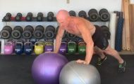The Single Arm Swiss Ball Push-up